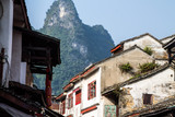 Street view of Yangshuo town and looming karsts behind it.