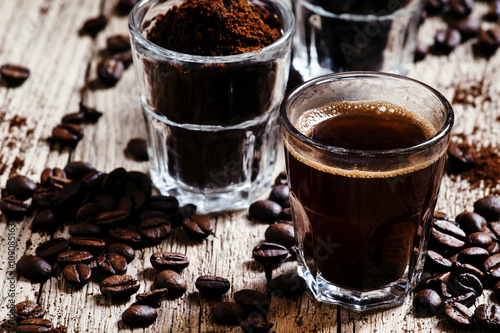 Black espresso coffee and ingredients for cooking: roasted coffe