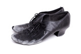 closeup shot of pair of worn-out latin ballroom dance shoes - isolated
