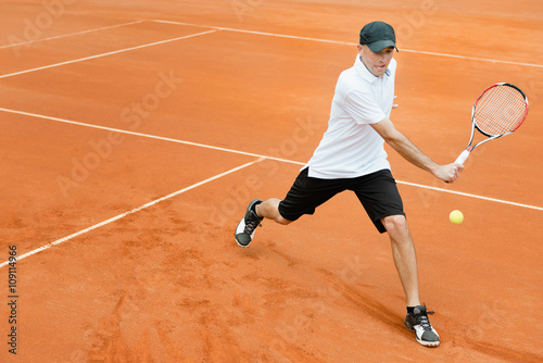 Tennis player in action Poster