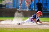 Fototapety Little league baseball player sliding home.