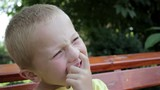 Boy Picking His Nose/boy laughing and pushed a finger in the nose without teeth