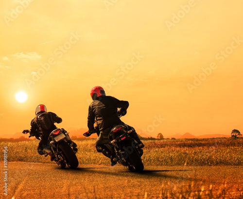 obraz PCV couples friend motorcycle rider biking on asphalt highway agains