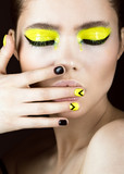 portrait of girl with yellow and black make-up, creative nail art disign. Beauty face.