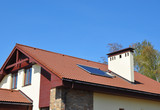 Cozy house Roofing with Vacuum Solar Water Panel Heating, Solar Panels, Skylights Outdoor.