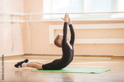 Boy dancer doing exercise at ballet dance class  © Andrey Bandurenko
