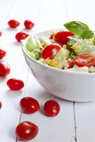 Tomato salad with cucumber, cheese and basil