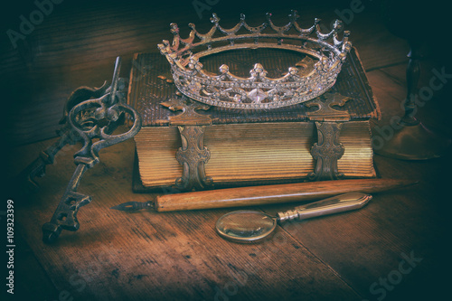 queen crown on old book. fantasy middle age concept