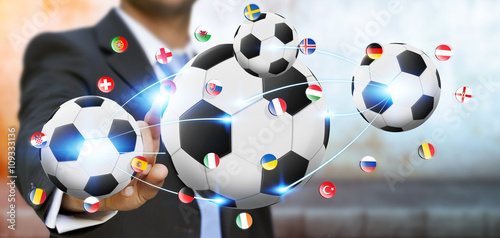 Businessman holding football in his hand