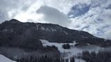 Winter mountain timelapse with snow and clouds