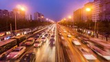The bird's view of the busy second ring road traffic and buildings in Beijing, China. Slow motion  - 109349799