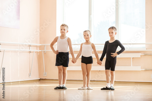 Young boys and a girl with posing at ballet dancing class © Andrey Bandurenko