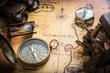 Old compass, sextant on vintage map. Retro style.