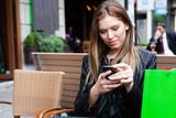 Female shopper texting