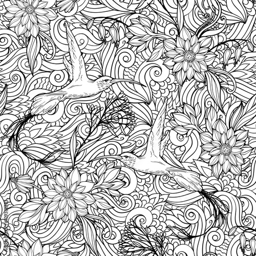 seamless pattern of flowers and hummingbirds.