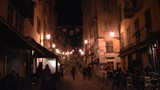 Walking a dark but lighted back street in Nice, France in the evening.