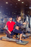 Personal trainer helping woman working with lunges, leg coaching