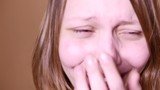 Closeup portrait of an emotional attractive laughing teen girl. 4K UHD