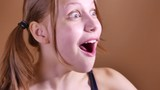 Surprised teen girl, funny face. 4K UHD