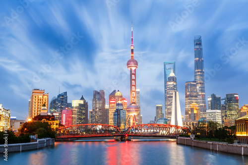 Beautiful modern city at night in Shanghai, China Poster