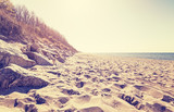 Vintage toned beach at sunset. - 109485728