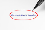 Electronic Funds Transfer on white paper - Business Concept