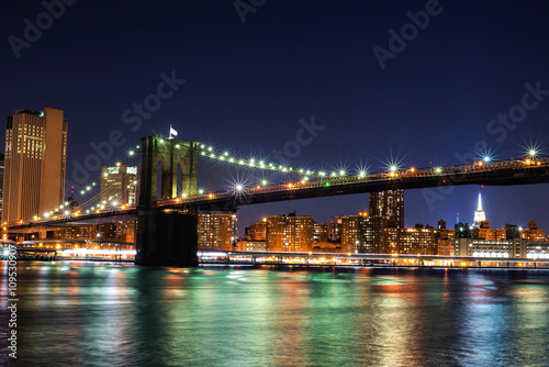 Zdjęcia na płótnie, fototapety, obrazy : Beautiful New York City view of the Brooklyn Bridge looking towards Manhattan at night