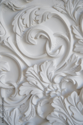 Luxury white wall design bas-relief with stucco mouldings roccoco element © romankosolapov