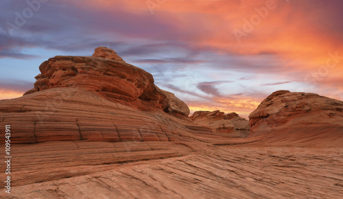Poster Oranje eclat Highly Eroded Sandstone Rocks at Sunset Glen Canyon, Arizona