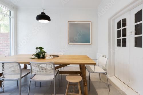 Modern scandinavian styled interior dining room with pendant lig