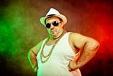 italian funny mafia boss rapper with undershirt and sunglasses on smoky background