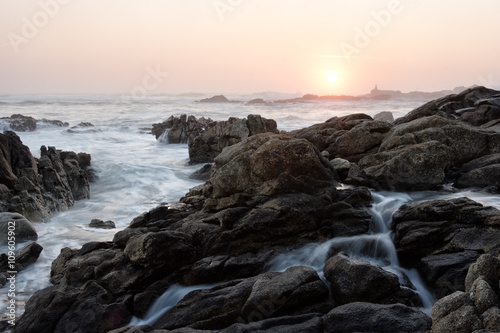 Rocky beach at sunset