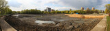 Repairs in the city park - pond without water - panorama
