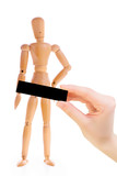 Wooden man with a hand holding a black rectangle. Isolated on white