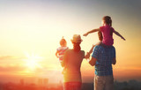 Fototapety happy family at sunset.