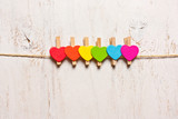 heart rainbow of colors on a white wooden background
