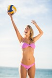 Woman playing beach volley