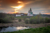 Beautiful landscape. Russian Orthodox church at sunset. The arch