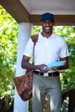 Portrait of postman delivering letter
