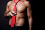 Sexy shirtless man with red tie