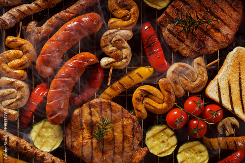 Fototapeta Mix products from the grill. View from the top, perfect for back