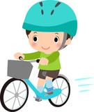 ヘルメットをかぶって自転車に乗る男の子