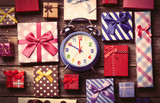 colorful gifts and clock on the table