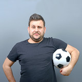 Portrait of chubby man holding football - Football fan supporter