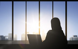 silhouette of business woman with laptop
