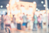 Blurred background,crowd of people in expo fair with bokeh light