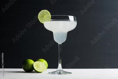 Plagát, Obraz Cocktail margarita on the dark wooden background