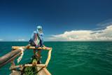 Woman enjoying time on the traditional fisher boat in Zanzibar