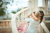 Gorgeous, lovely bride and handsome groom hugging in emotional e