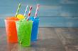 Colorful summer slushies on wood